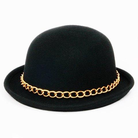 chapeau melon avec chaîne dorée